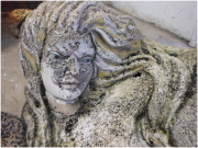 stone sculpture of mermaid